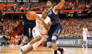 Syracuse forward Kris Joseph drives against UConn