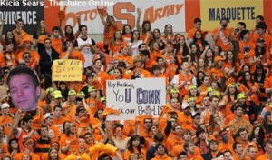 Syracuse's crowd at the Carrier Dome holds up signs during a timeout