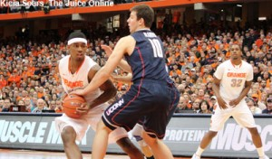 Syracuse forward CJ Fair drives against Tyler Olander of UConn