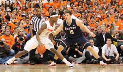 Syracuse forward CJ Fair drives against UConn's Tyler Olander