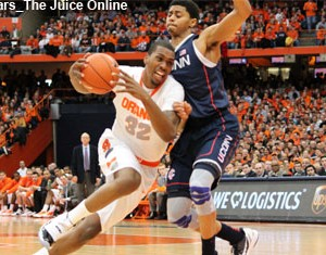 Syracuse forward Kris Joseph drives against UConn