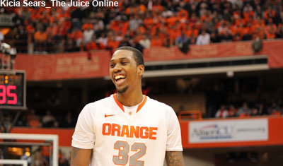 Syracuse forward Kris Joseph smiles