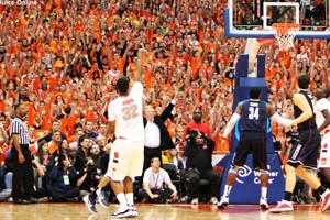 Syracuse forward Kris Joseph hits a shot against UConn