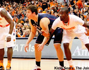 Syracuse center Baye Keita boxes out UConn's Tyler Olander for a rebound