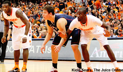 Syracuse center Baye Keita boxes out UConn's Tyler Olander for a rebound