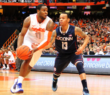 Syracuse G Scoop Jardine drives against UConn