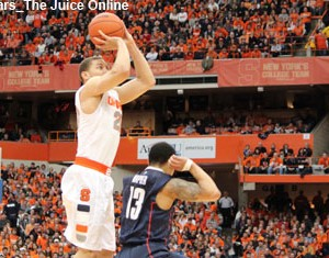 Syracuse G Brandon Triche shoots against Uconn
