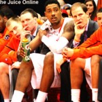 Syracuse center Fab Melo looks on from the bench