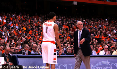Syracuse coach Jim Boeheim and guard Michael Carter-Williams speak to each other