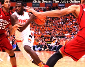 Syracuse guard Dion Waiters drives against Louisville