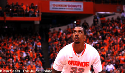 Syracuse forward Kris Joseph shoots from the free throw line