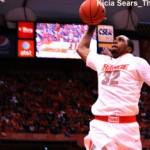 Syracuse forward Kris Joseph goes up for a dunk against Louisville