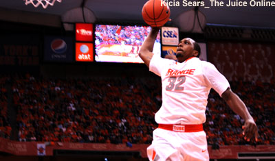 Syracuse forward Kris Joseph goes up for a dunk against Louisville