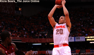 Syracuse guard Brandon Triche shoots against Louisville