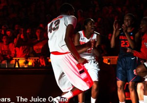 James Southerland dances with the women's basketball team at Orange Madness
