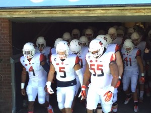 Syracuse captains (from l to r) Zaire Franklin, Luke Arcinega, and Rob Trudo lead the Orange out against Virginia Sat. afternoon